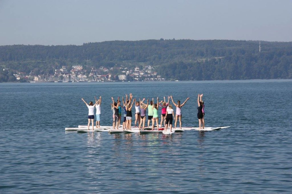 paddle board yoga with stand up paddle board